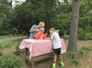 Here they are serving lemonade on that hot afternoon!